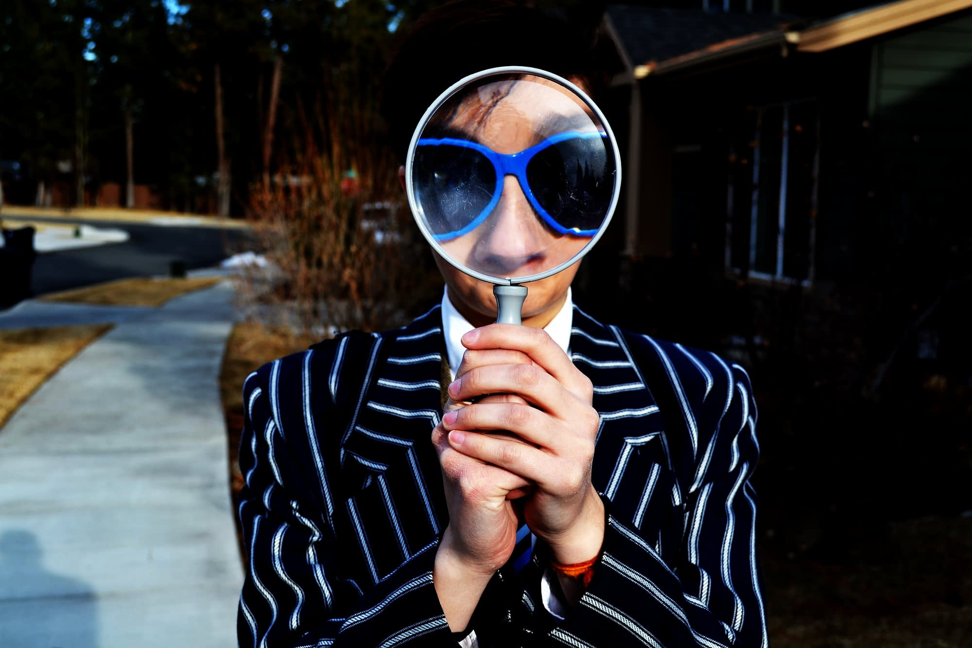person with magnifying glass - photo by mar newhall